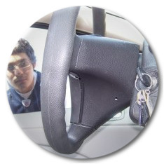 Kid looking through his car window at keys locked in ignition
